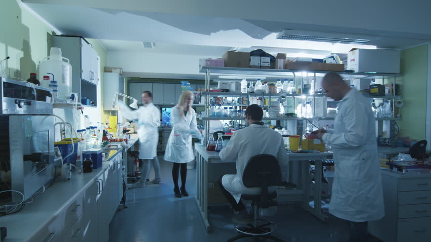 Timelapse footage of a team of scientists in white coats that are working in a modern laboratory. Shot on RED Cinema Camera in 4K (UHD). #13089422