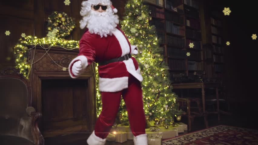 Santa Claus in sunglasses dancing, tracking shot, snowflakes on background tracking shot | Shutterstock HD Video #13126142