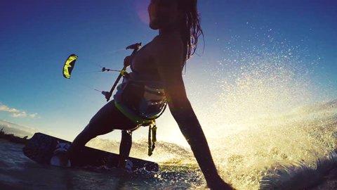 Beautiful Girl Having Fun Summer Extreme Water Sports Kite Surfing in Bikini. Slow Motion.