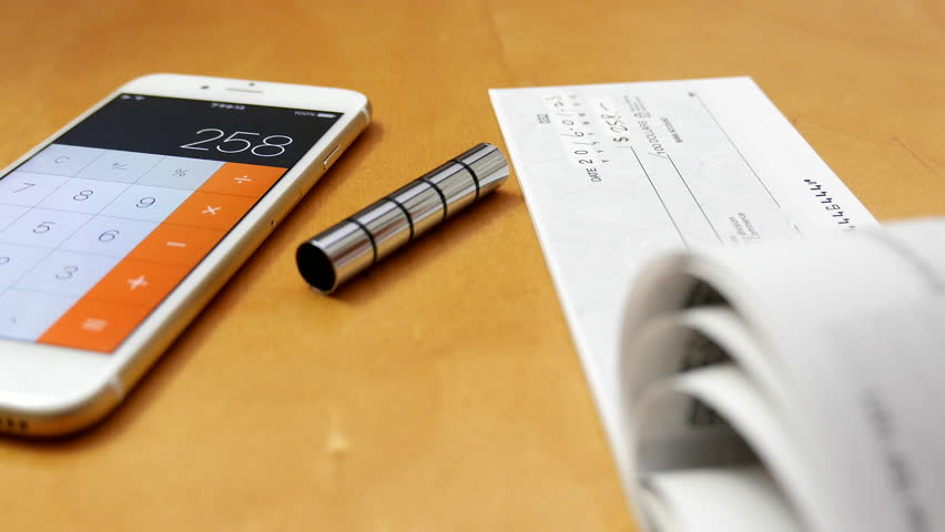 Coquitlam, BC, Canada - December 04, 2015 : Business man signing a cheque with 4k resolution