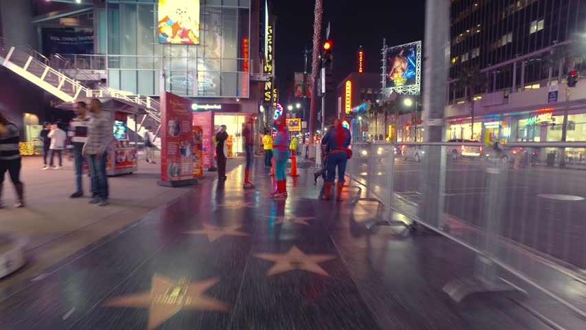 HOLLYWOOD, CA - December 9, 2015: Hectic POV walk on Hollywood Blvd Walk of Fame at night. 4K UHD Timelapse hyperlapse view. | Shutterstock HD Video #13229552