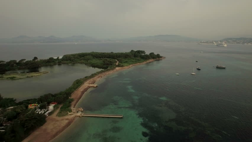 Cannes Aerial v11 Flying low over Sainte-Marguerite island panning right with Cannes view.