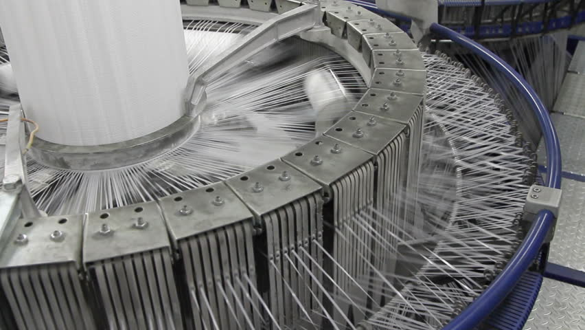 Textile industry - yarn spools on spinning machine in a factory | Shutterstock HD Video #13277852