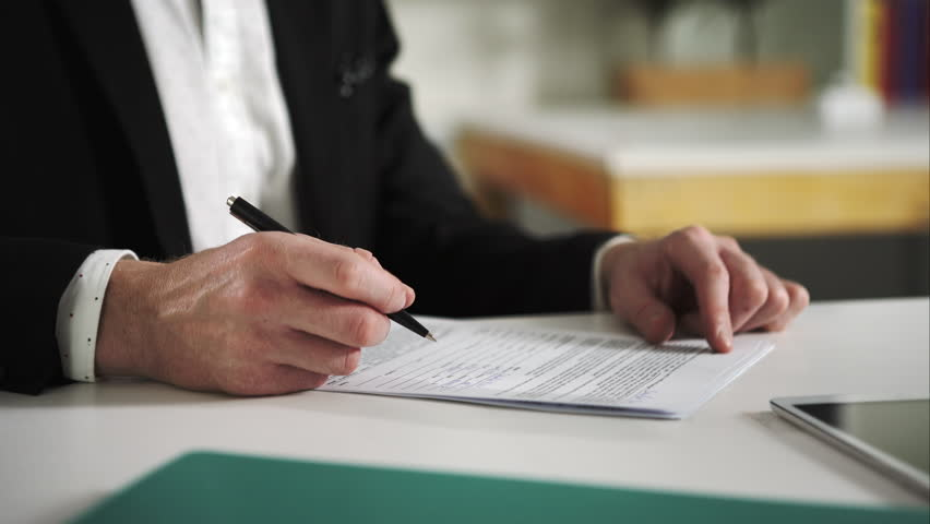 Man sign documents turning over the sheets. UHD | Shutterstock HD Video #13281782