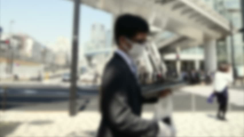 Defocused timelapse of a business district in downtown Tokyo. | Shutterstock HD Video #13289222