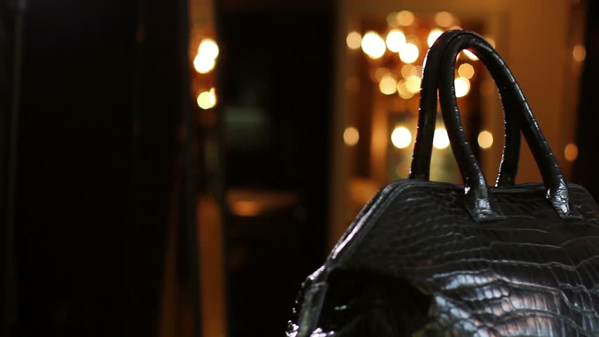 Leather bag in the shop window of the boutique. Bag made of crocodile skin.