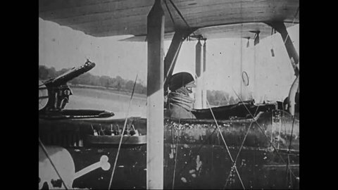 CIRCA 1910s - Captured German war film from World War One shows German airplanes loading up for a raid on Allied forces.