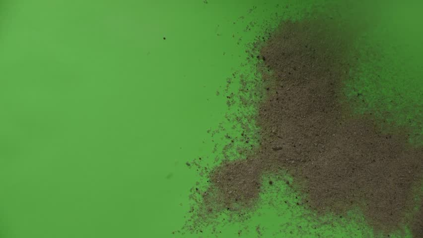 Heaps of Dry Sand is Flying at the Wind, Sand at Warm Airstream from the Dryer, Sand on Chroma Key, Sand on Green Background,Studio, Indoors, Nested Sequence