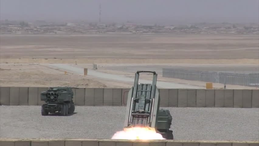 CIRCA 2010s - U.S. Marines launch rockets from a High Mobility Rocket launcher system in against enemy targets in the Middle East.