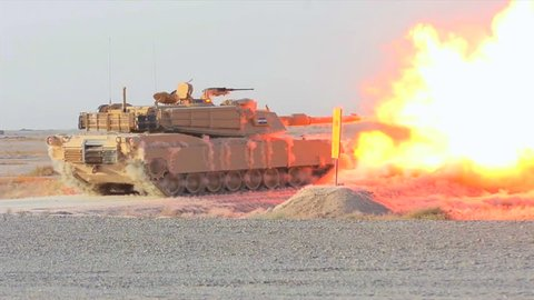 CIRCA 2010s - Abrams tanks fires during the Iraq War.