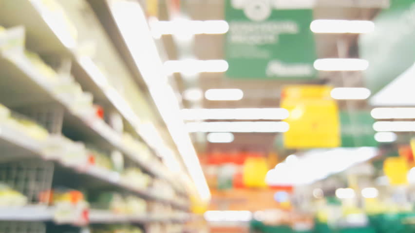 Blurred background Supermarket store motion people with bokeh