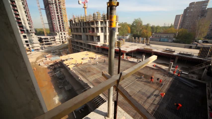 Cityscape from unfinished building, camera moves and show construction site