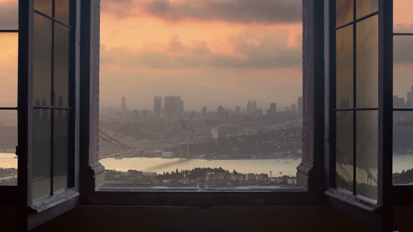 Timelapse of istanbul city skyline cityscape starting at the sunset ending at night as seen from a window camera moving out the house