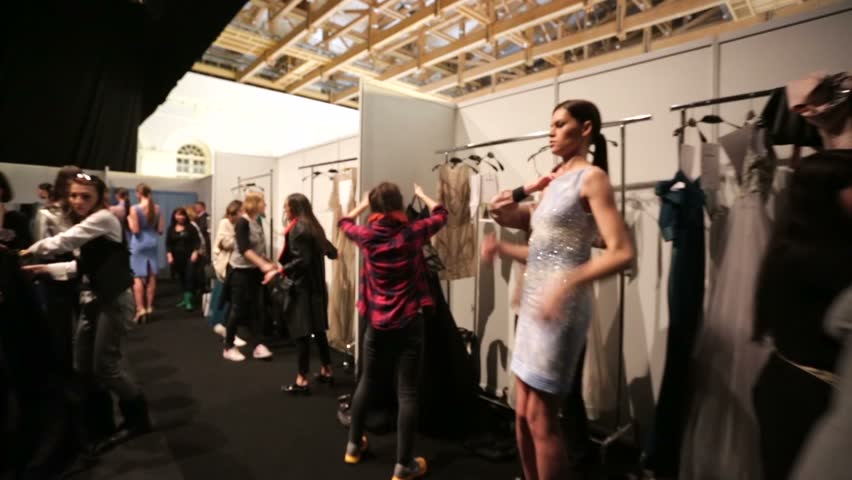 Fashion show backstage changing dress color