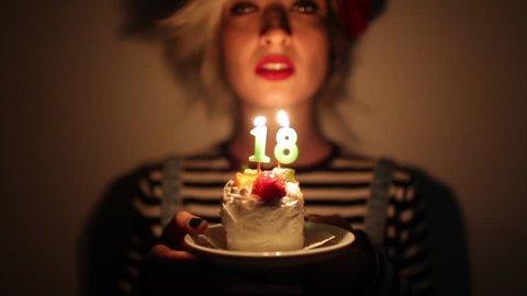 Teenage Girl Celebrating Her 18 Birthday With A Cake