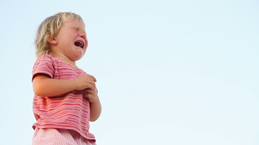 crying child on natural background