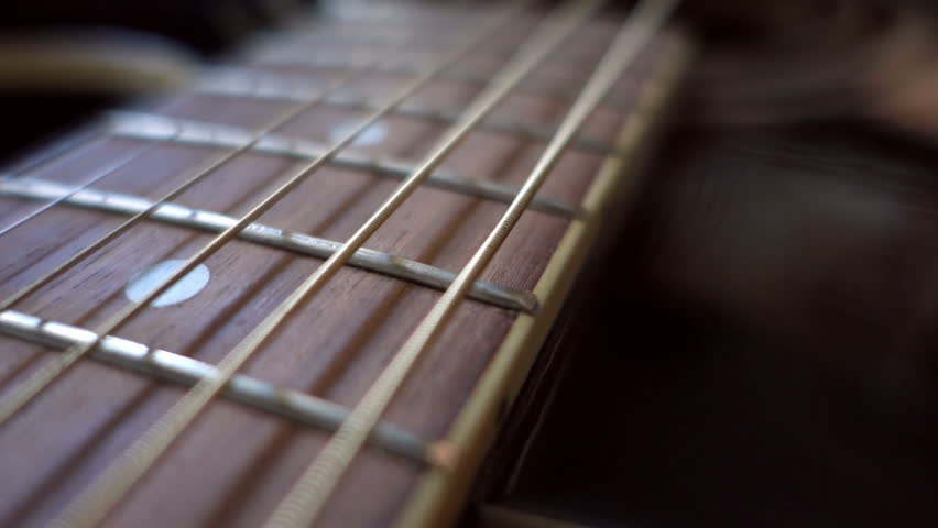 The Strings Vibrate At An Acoustic Guitar Fretboard Stock Footage Video 13427432