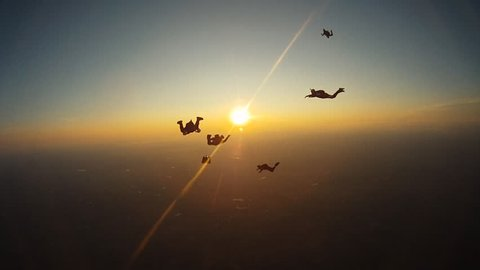 Skydiving people sunset