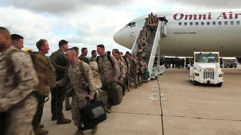 CIRCA 2010s - Soldiers return from deployment overseas to reunite with their families.