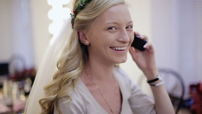 Bride speaks by the mobile phone and smiles | Shutterstock HD Video #13530152