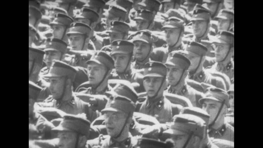1930s: Soldiers Cast Shadows on Ground as they March in Parade
