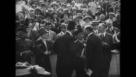 CIRCA 1920s - Calvin Coolidge and other cabinet officials speak before a large crowd and women are given the right to vote in 1919.