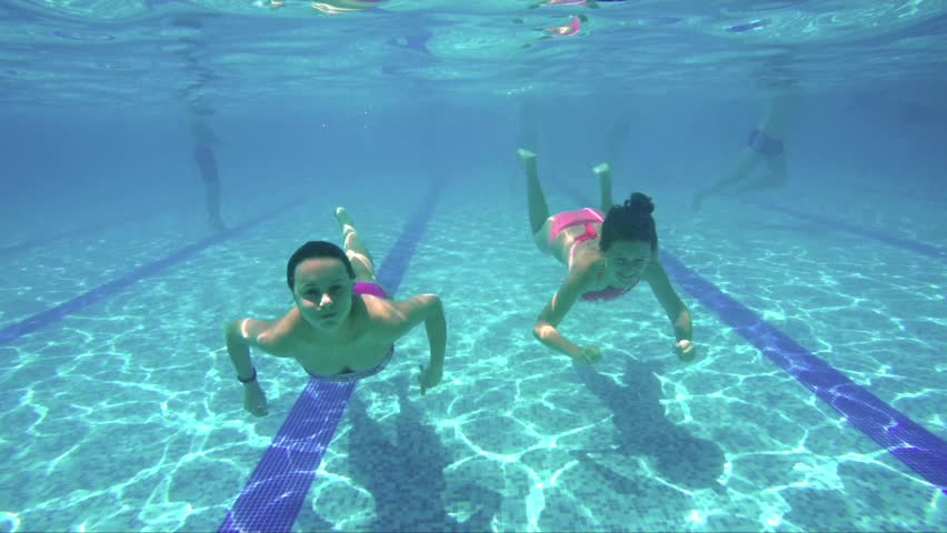 Kids Swimming Underwater young boy swimming underwater in a pool stock footage video