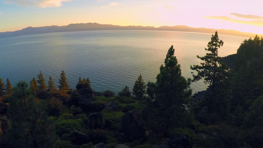 LAKE TAHOE, NEVADA - CIRCA 2015 - A beautiful aerial shot at dawn over Lake Tahoe. | Shutterstock HD Video #13596377