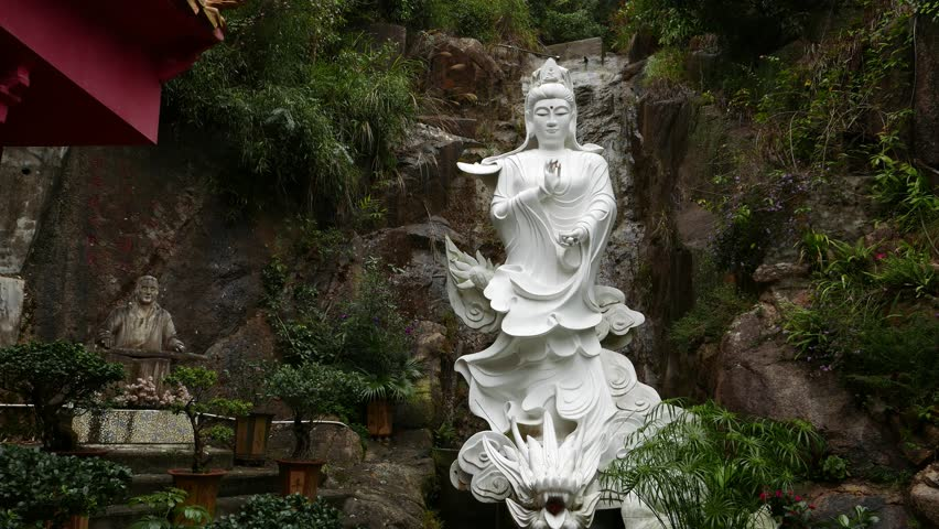 HONG KONG - FEBRUARY 23, 2015: White statue of Guanyin riding Dragon, extremely powerful, enhancing the chi. Ten Thousand Buddhas Monastery, Buddhist temple in Sha Tin, Hong Kong
