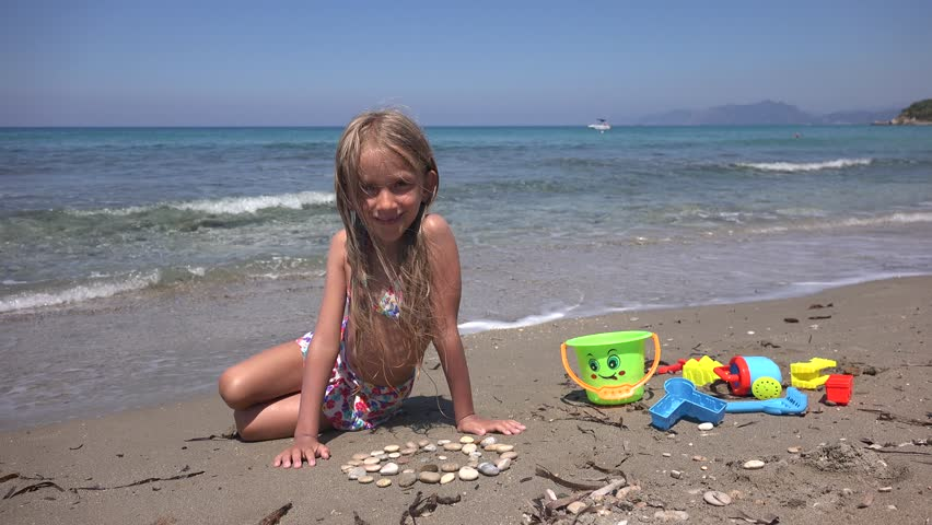 K Portrait Of Happy Little Girl Looking In Camera On Beach Child At Seashore