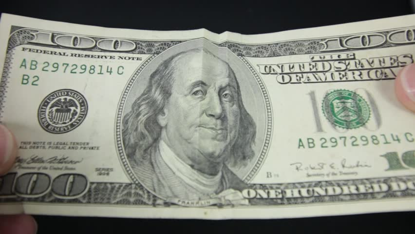 Ben Franklin smiles and frowns on a hundred dollar bill.  | Shutterstock HD Video #13637702