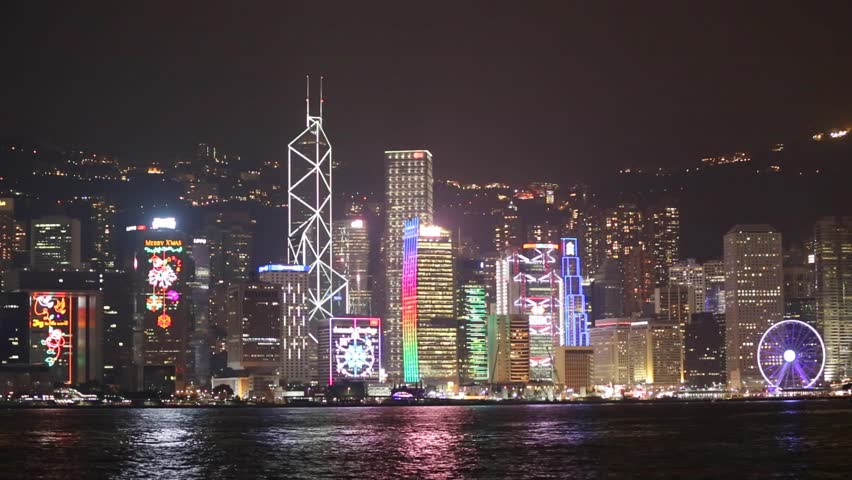 Skyscapers at Victoria's harbor and floating ship, Hong Kong | Shutterstock HD Video #13642445