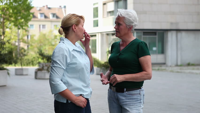 Two Older Women Meeting And Greeting In The City