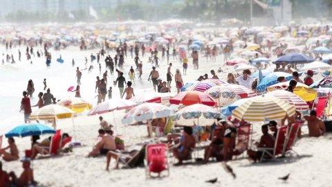 Huge Crowd at Copacabana Beach, Rio de Janeiro. RIO DE JANEIRO, BRAZIL - 30 DECEMBER 2015; Hot summer's day at Copacabana Beach with a huge crowd of people, Rio de Janeiro Brazil - Full HD