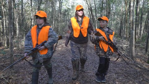 Woman hunter takes her two boys deer hunting. January in Georgia. Filmed with Gimbal rig.