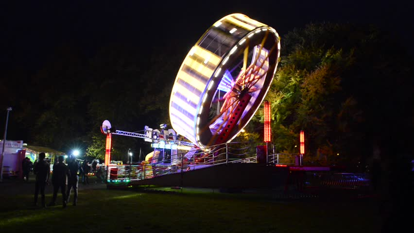 Faversham, Kent, UK - October 17, 2015: View of provincial fairground with various rides at dusk,Illustrative Editorial Footage #13679942
