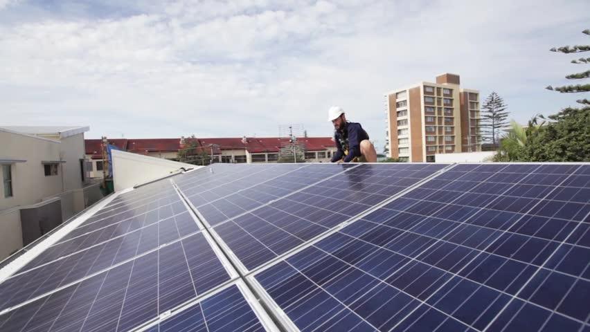 Solar Technician Installing Solar Panels On Roof.   HD Stock Video Clip