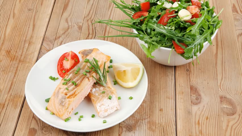 Savory sea fish : baked salmon strips with vegetable salad dish over wooden table 1920x1080 intro motion slow hidef hd | Shutterstock HD Video #13693142