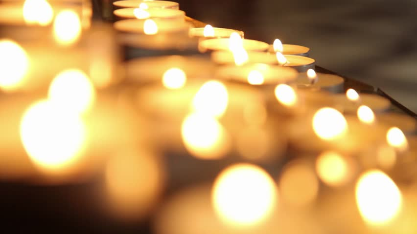 Stock video of lighted candles on table in catholic | 13715102 | Shutterstock & Stock video of lighted candles on table in catholic | 13715102 ...