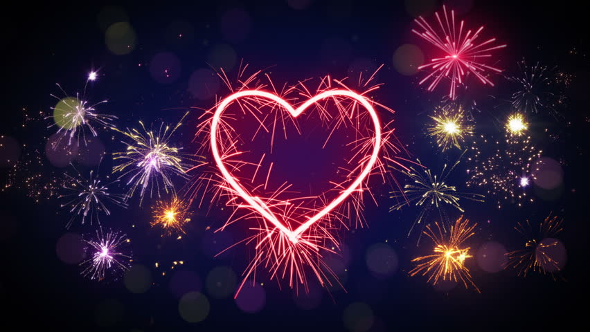 sparkler heart shape and fireworks stock footage video