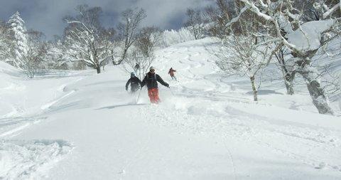Hokkaido, Japan - Group of skiers descending on a volcano. Ski powder snow hiking climbing free ride. Hokkaido, Japan February 2016.