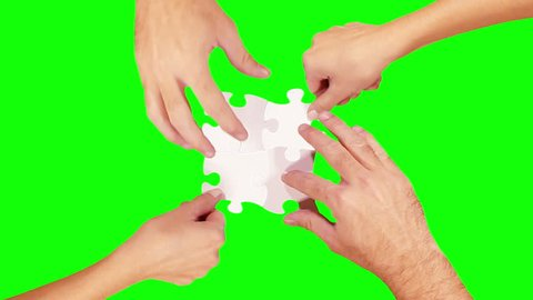 Hands solving a puzzle. 8 videos in one file. Female and male hands solving a blank puzzle. Green Screen.