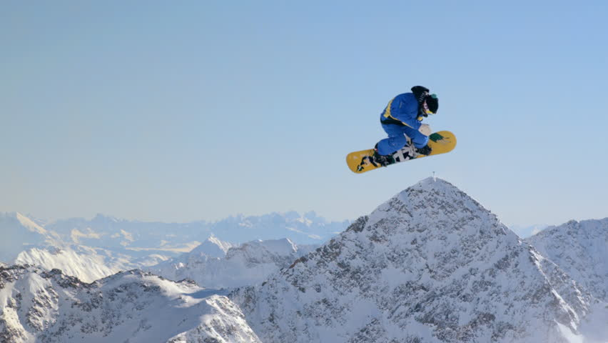 WS TS SLO MO View of snowboard jumping scene with snowy mountains / Stubai, Central Eastern Alps, Innsbruck, Austria - Stubai, Central Eastern Alps, Innsbruck, Austria, July, 2015 | Shutterstock HD Video #13844612