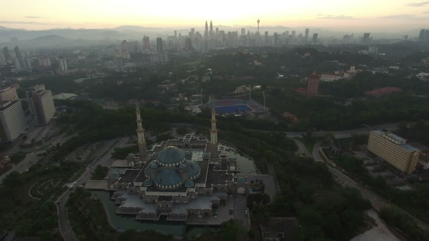 Aerial view of sunrise at Federal Mosque Kuala Lumpur with city skyline at the background | Shutterstock HD Video #13901162