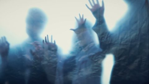 Silhouettes of lost souls escaping from underworld, ghosts in haunted house, zombie. Shadows scratching, blood-chilling thriller, frightening monsters nightmare. Demonic hands trying to catch victim