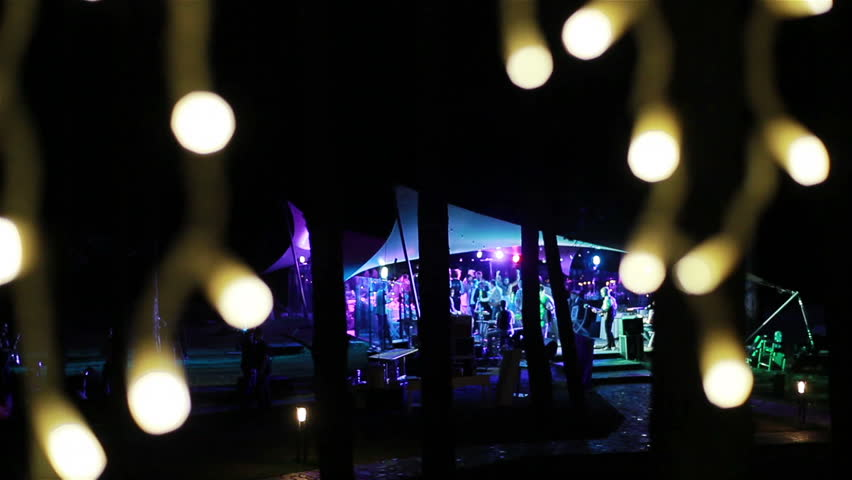 People dancing at a party in an outdoor nightclub terrace  | Shutterstock HD Video #13926692