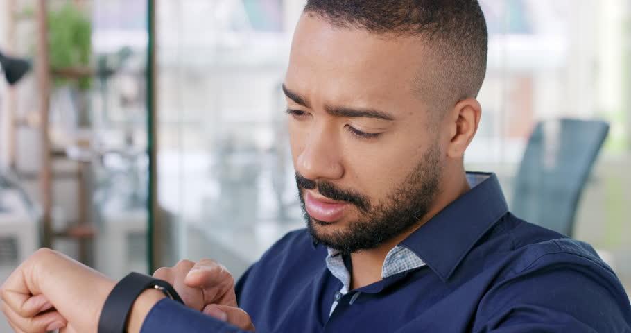 Businessman using smart watch app connecting digital device in modern office | Shutterstock HD Video #13949807