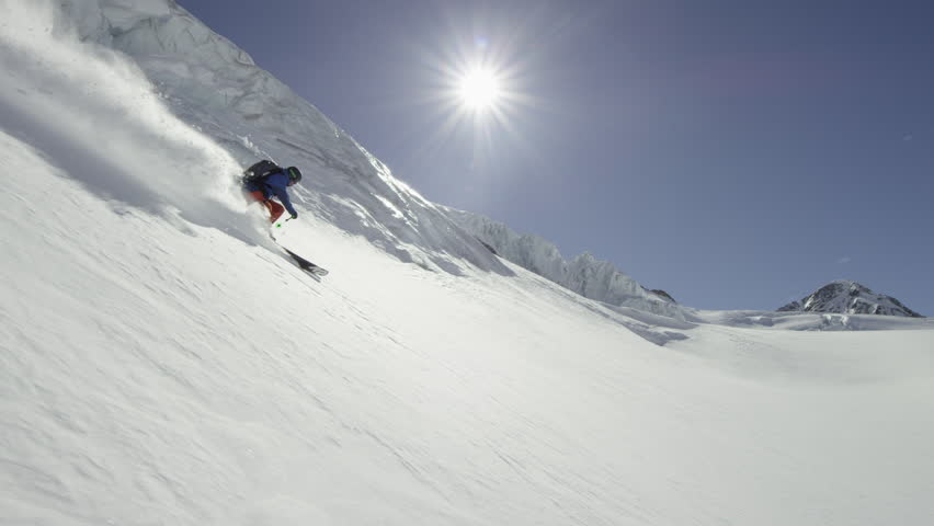 WS TS Man freestyle skiing on Wildspitze on sunny day / North Tyrol, Austria #13978352