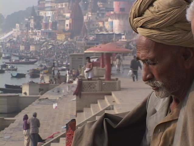 VARANASI, INDIA - CIRCA 2010: An Indian mystic, also known as a wise man or guru, sits beside gnats in circa 2010 Varanasi, India.