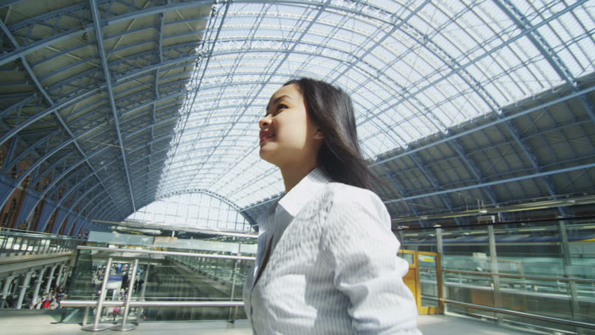 4k / Ultra HD version Businessman and businesswoman meet and shake hands at St. Pancras railway station in London. In slow motion. Shot on RED Epic | Shutterstock HD Video #13999022